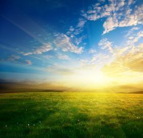 Spring sunrise sunset grass field blue sky white clouds
