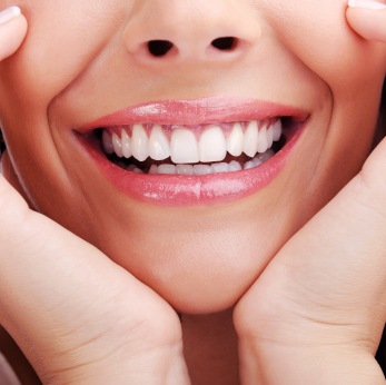Close up woman smile with hands framing face