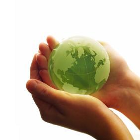 Green Earth Globe in palms hands