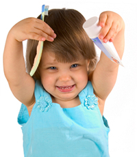 Little girl with toothbrush and paste  toothpaste