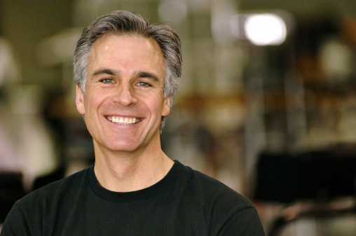 mature man smiling with greying hair